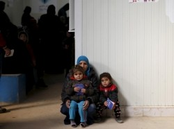 Syrian refugees wait to receive treatment at a health center in Mafraq, Jordan, January 30, 2016