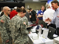 Soldiers meet with civilian recruiters at a job fair at Fort Huachuca, Arizona
