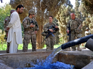 Key Leader Engagement attendees observe a solar-powered water pump while discussing ongoing projects in Farah province, Afghanistan, September 28, 2013
