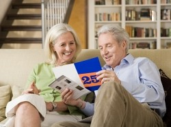 Senior couple reading a brochure they received in the mail