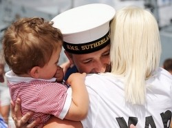 A Royal Navy sailor is reunited with his family after a long deployment with HMS Sutherland overseas