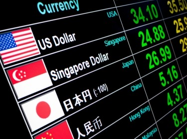 Currency exchange rates are displayed on a digital LED screen