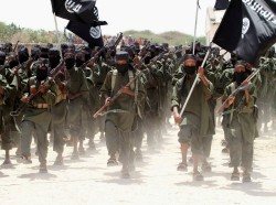 New recruits belonging to Somalia's al-Qaeda-linked al Shabaab group march during a parade at a military training base in Afgoye, Somalia, February 17, 2011