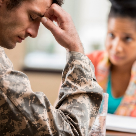 Depressed veteran meets with psychologist