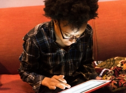 African American woman making selections on a tablet
