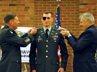 2nd Lt. Peter Sprenger receives his second lieutenant bars from Gen. David Petraeus and his father, Nov. 19, 2009, U.S. Army Photo