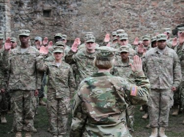 Knights Brigade Soldiers take the oath of reenlistment in the courtyard of the Burg Lichtenberg castle in Kusel, Germany, April 1, 2016