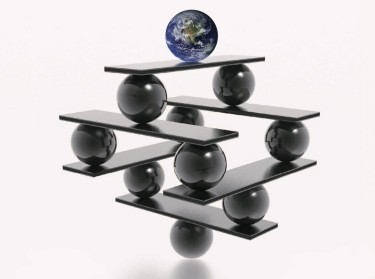 A globe and marbles balancing