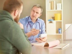 Primary care physician talking to a patient
