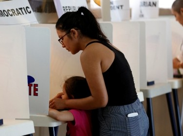 First-time voter Brianna Macias votes at Assumption Church during the U.S. presidential primary election, June 7, 2016