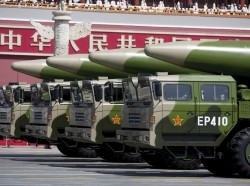 Military vehicles carrying DF-26 ballistic missiles travel past Tiananmen Gate during a military parade to commemorate the 70th anniversary of the end of World War II in Beijing, September 3, 2015