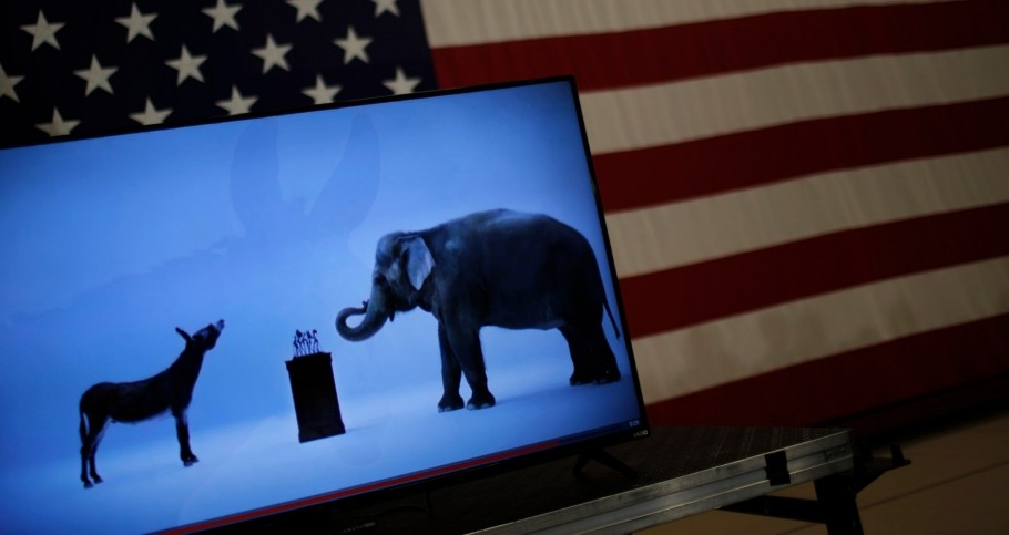 The mascots of the Democratic and Republican parties are seen on a video screen at U.S. presidential candidate Hillary Clinton's campaign rally in Cleveland, Ohio, March 8, 2016