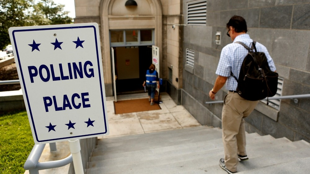 A man enters a polling station as District of Columbia voters head to the polls in the final 2016 U.S. Democratic primary in Washington, DC