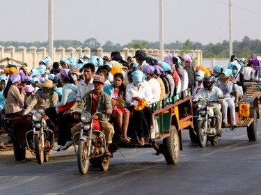 Cambodian garment factory workers travel home from work in Kampong Chhnang province, north of Phnom Penh