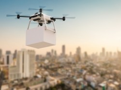 A delivery drone flying over a city