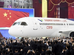 The first C919 passenger jet made by the Commercial Aircraft Corp of China (Comac) during a news conference at the company's factory in Shanghai, November 2, 2015