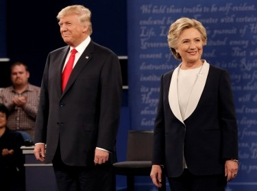Republican U.S. presidential nominee Donald Trump and Democratic U.S. presidential nominee Hillary Clinton during their presidential town hall debate at Washington University in St. Louis, Missouri, October 9, 2016