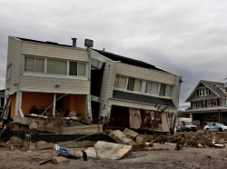 The remains of houses destroyed during Hurricane Sandy are seen in the Rockaways area of New York's borough of Queens, January 14, 2013