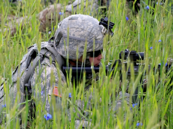 A U.S. soldier takes part in a defense exercise with British and Lithuanian soldiers in Mikyciai, Lithuania, June 17, 2017