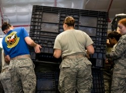 Airmen from the 23d Logistics Readiness Squadron lift a crate