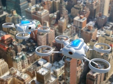 Police drones simulation with blue emergency lights flying over New York City