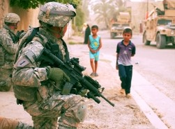 U.S. Army Soldiers provide security during a mission in Yarmouk, Iraq, July 2007