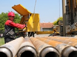 An oil and gas worker operates a drilling rig