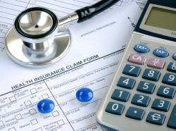 calculator, pills, and stethoscope