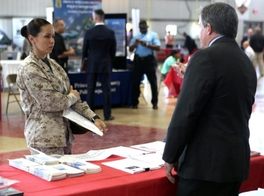 A drill instructor talks to a representative from the FBI to seek information about employment opportunities during a career and education fair at the Marine Corps Recruit Depot, Parris Island, April 16, 2013