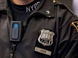 A police body camera is worn by an officer during a news conference on the pilot program of body cameras involving 60 NYPD officers dubbed Big Brother at the NYPD police academy in Queens, New York, December 3, 2014