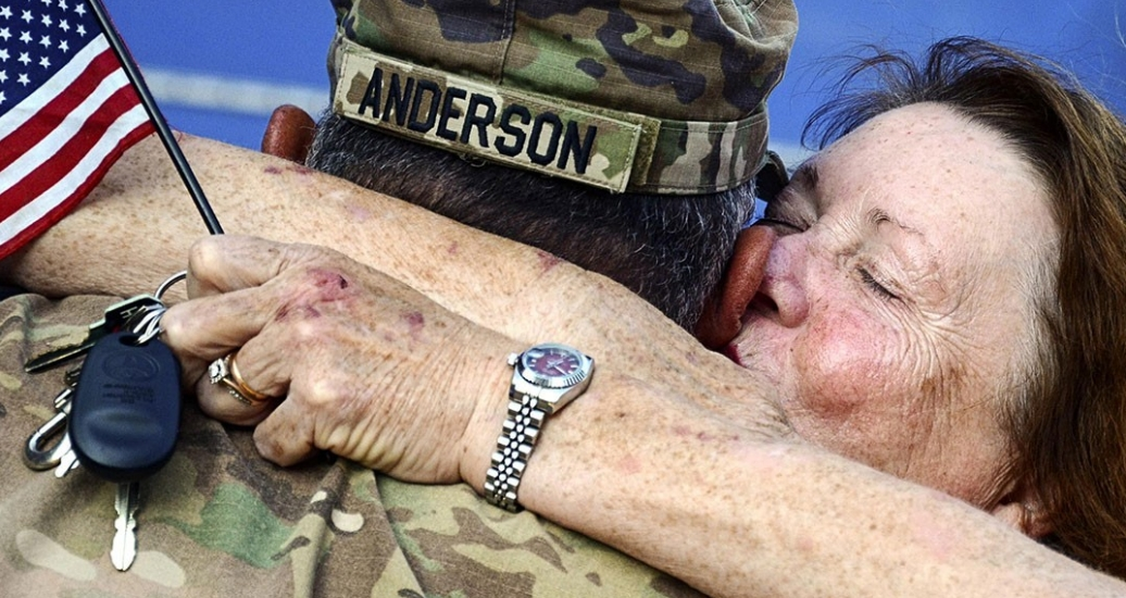 An Army National Guardsman embraces a loved one upon returning to Virginia, July 10, 2017, from a deployment to the Middle East supporting Task Force Spartan Shield.