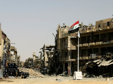 An Iraqi flag is seen amid destroyed buildings in the Old City of Mosul, Iraq, July 23, 2017
