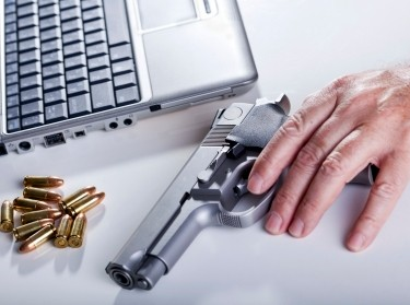 A laptop computer, a 9mm handgun, and bullets