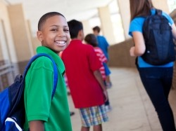A boy walking in a school hallway