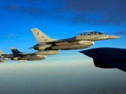 F-16 Fighting Falcons from the Pakistan Air Force fly to a joint exercise with the air forces of the United States and its allies, Nevada, July 21, 2010