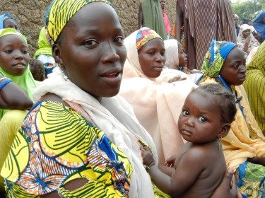 Woman attends a health education session in northern Nigeria