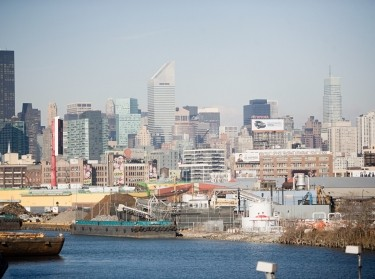 New York City skyline with ships in the foreground