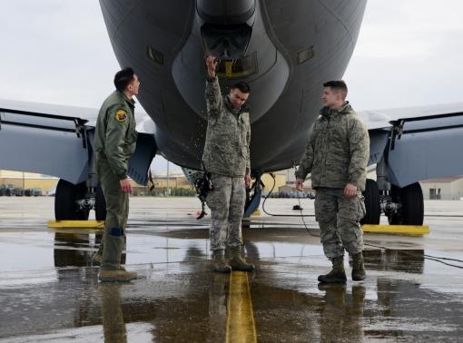 Senior Airman Luis Perfino and Senior Airman Dane Haugbom, 940th Aircraft Maintenance Squadron crew chiefs, walk a KC-135 Stratotanker pilot through a preflight inspection Jan. 17, 2019, at Beale Air Force Base, Calif., photo by Senior Airman Tristan D. Viglianco/U.S. Air Force