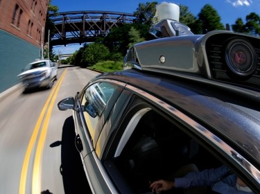 A self-driving Uber drives in Pittsburgh during a media preview