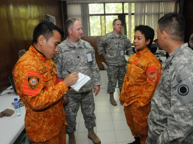 U.S. Army personnel with members of the Special Rescue Unit, Bureau of Fire Protection, National Capital Protection at Camp Aguinaldo, Manila, Philippines