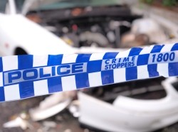 Cordon tape at the scene of an accident in Australia, photo by STRINGERimage/Getty Images