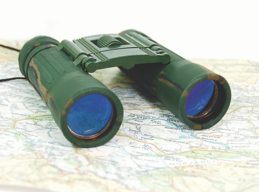 Binoculars on a map