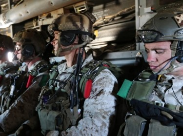 Marines prepare to jump using a static line