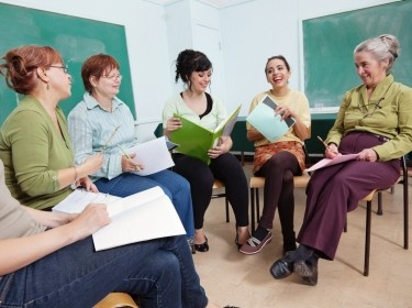 Group of teachers meeting in a classroom