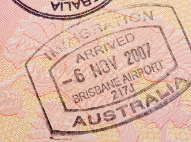 Passport page with the immigration control of Australia stamp