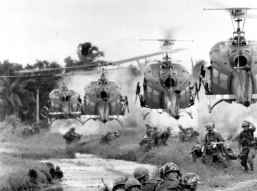 Ferrying South Vietnamese rangers, U.S. helicopters swoop in on a landing zone on the fringe of a pineapple plantation in the Mekong Delta on August 21, 1967