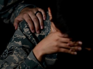 One soldier comforts a depressed soldier, photo by A1C Kathryn R.C. Reaves/U.S. Air Force