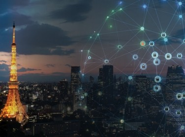 Cybersecurity locks illustration superimposed over a photo of Tokyo at night