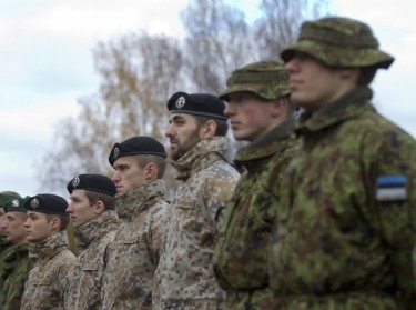 Lithuanian, Latvian, and Estonian soldiers stand in formation for the closing ceremony of exercise Silver Arrow in Adazi, Latvia, October 31, 2016