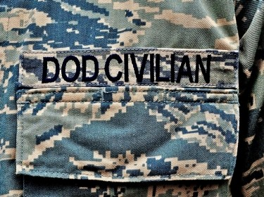 Close-up shot of the uniform of a member of the Department of Defense Civilian Expeditionary Workforce